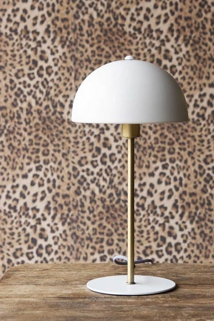 Lifestyle image of the Art Deco Canopy Table Lamp - Matt White with Rockett St George Leopard Love Wallpaper in the background