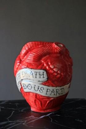 Anatomical Heart Vase on dark table and grey background lifestyle image