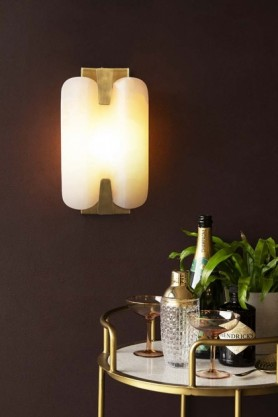 Lifestyle image of the Art Deco Marble Plate Wall Light switched on