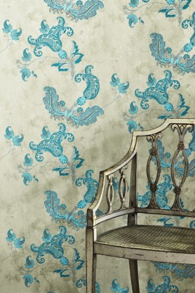 Turquoise patterns on old grey wallpaper with a vintage chair in front of it - Rockett St George