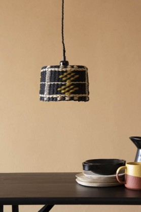 Lifestyle image of the Black, Natural & Yellow Rope Lamp Shade over dining table with tableware on it with cloisters painted background