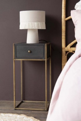 Lifestyle image of the entire Sophos Single Drawer Bedside Table next to a bed with a lamp on top