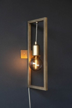 Lifestyle of Brass Effect Hanging Lamp In Frame fixed to the wall bulb on