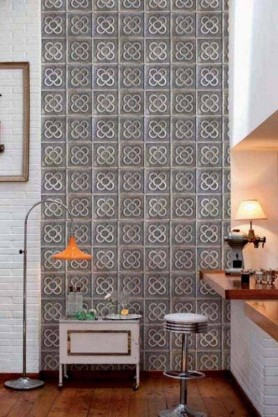 Clover wallpaper featured in a room with a bar stool and small white side table