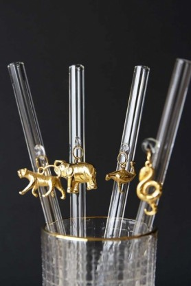 Collection of 4 drinking straws in a glass showing all 4 golden animal charms