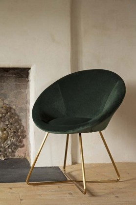 Homely lifestyle image of the The Grand Velvet Circular Dining Chair in Rich Green