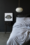 Lifestyle image of the Cruz Opal Pendant Light in a bedroom