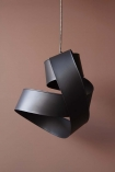Image of Black Twisted Ribbon Ceiling Light against mauve wall background