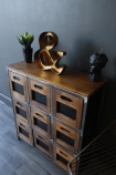 9 drawer wooden storage chest of drawers lifestyle image angled