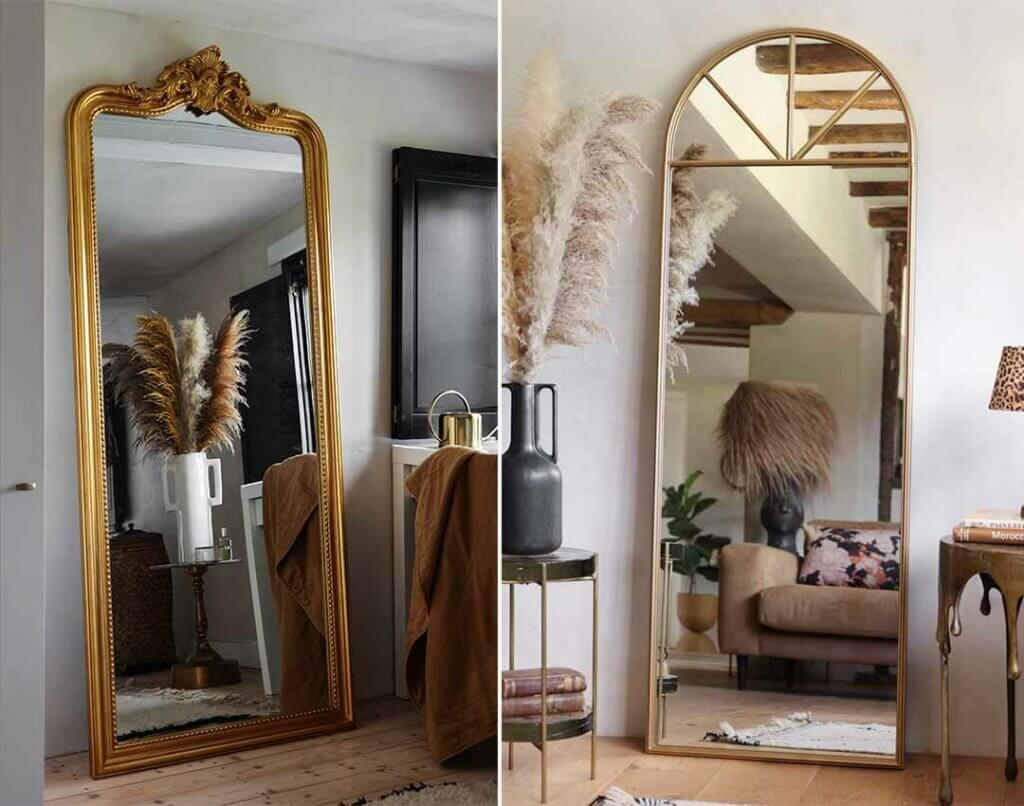 image of 2 tall and large mirrors with gold metal surround