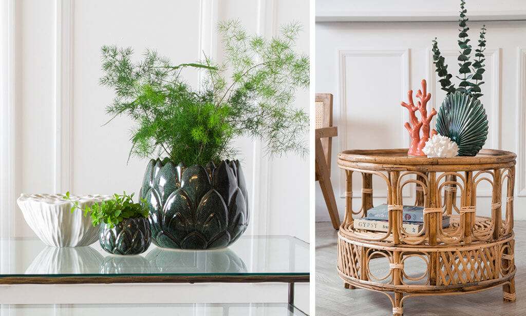 two coffee tables with vases filled with green plants and eucalyptus.