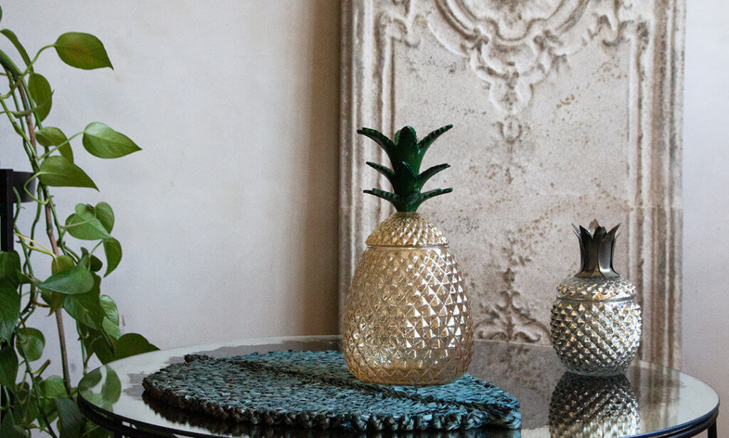 two pineapple storage jars on a coffee table