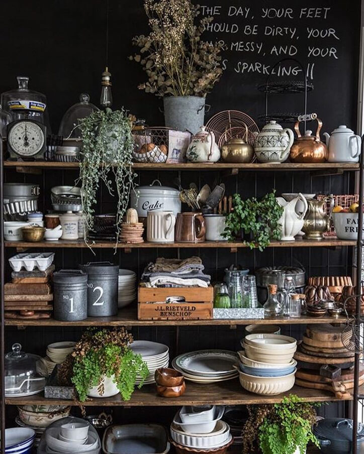 A shelved unit showcasing an organised mess of crockery.
