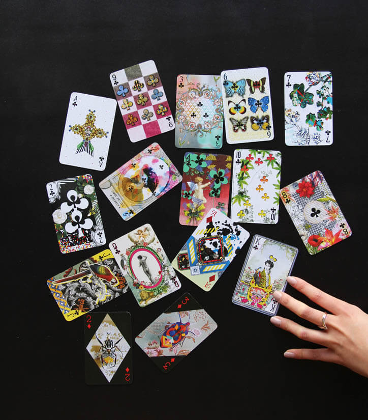 Lacroix playing cards organised randomly on a table