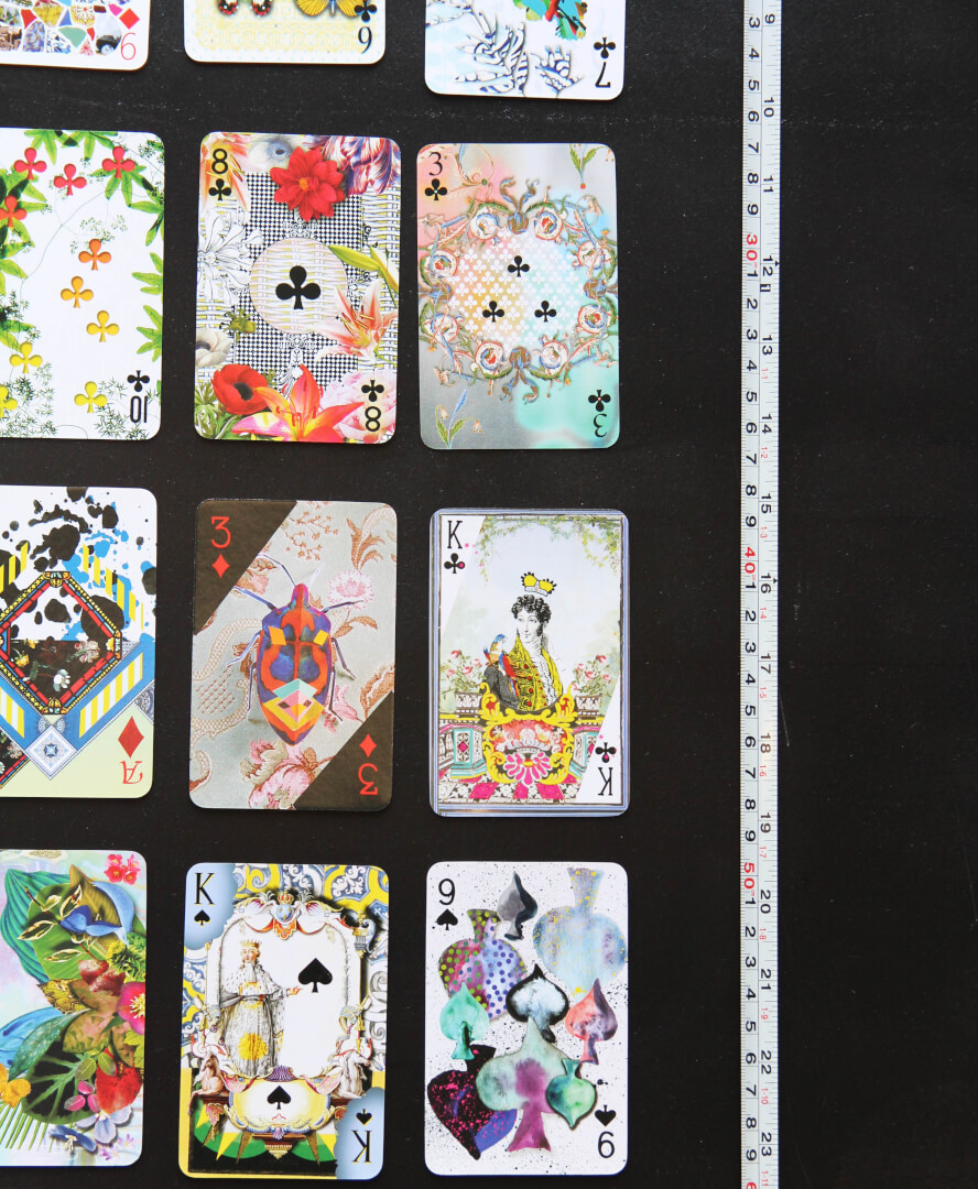 Lacroix playing cards next to a tape measure