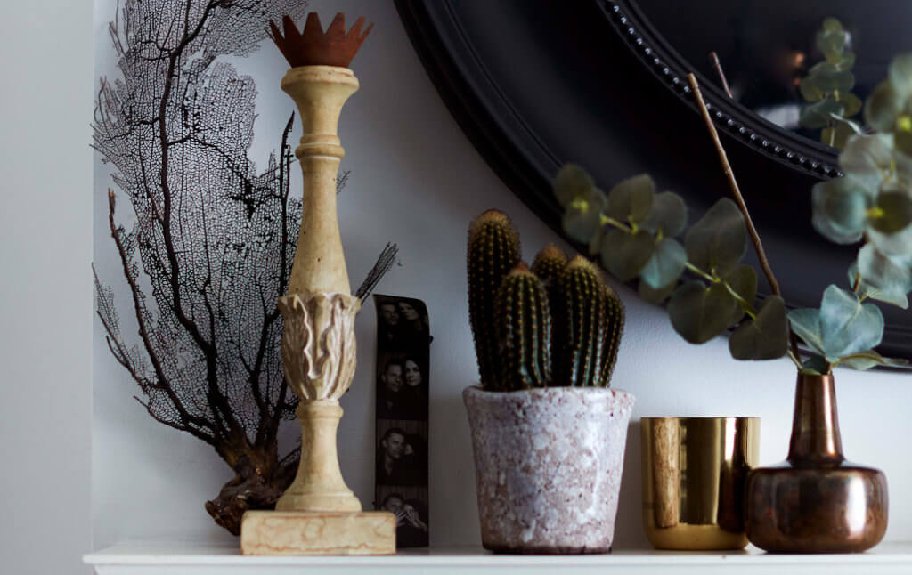 shelf art of display featuring vases, candlesticks and photos