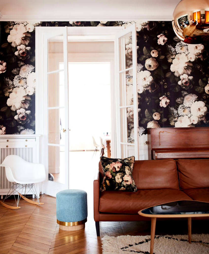 A flash of dramatic floral wallpaper adds impact and vibrancy to Quentin's living room. As featured in Rockett St George:Extraordinary Interiors