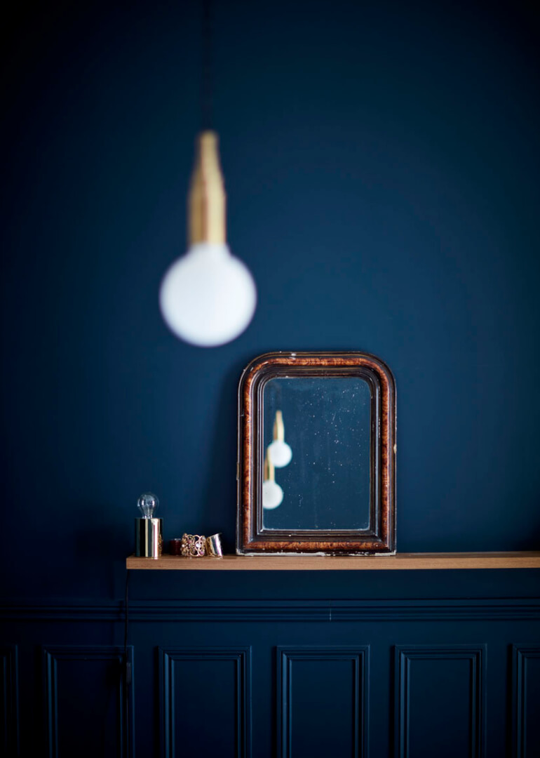 Quentin's bedroom featuring inky blue and soft with golden accents. As featured in Rockett St George:Extraordinary Interiors