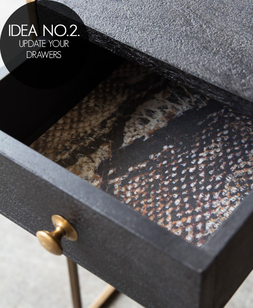 Image of draw open and lined with sexy snakeskin wallpaper