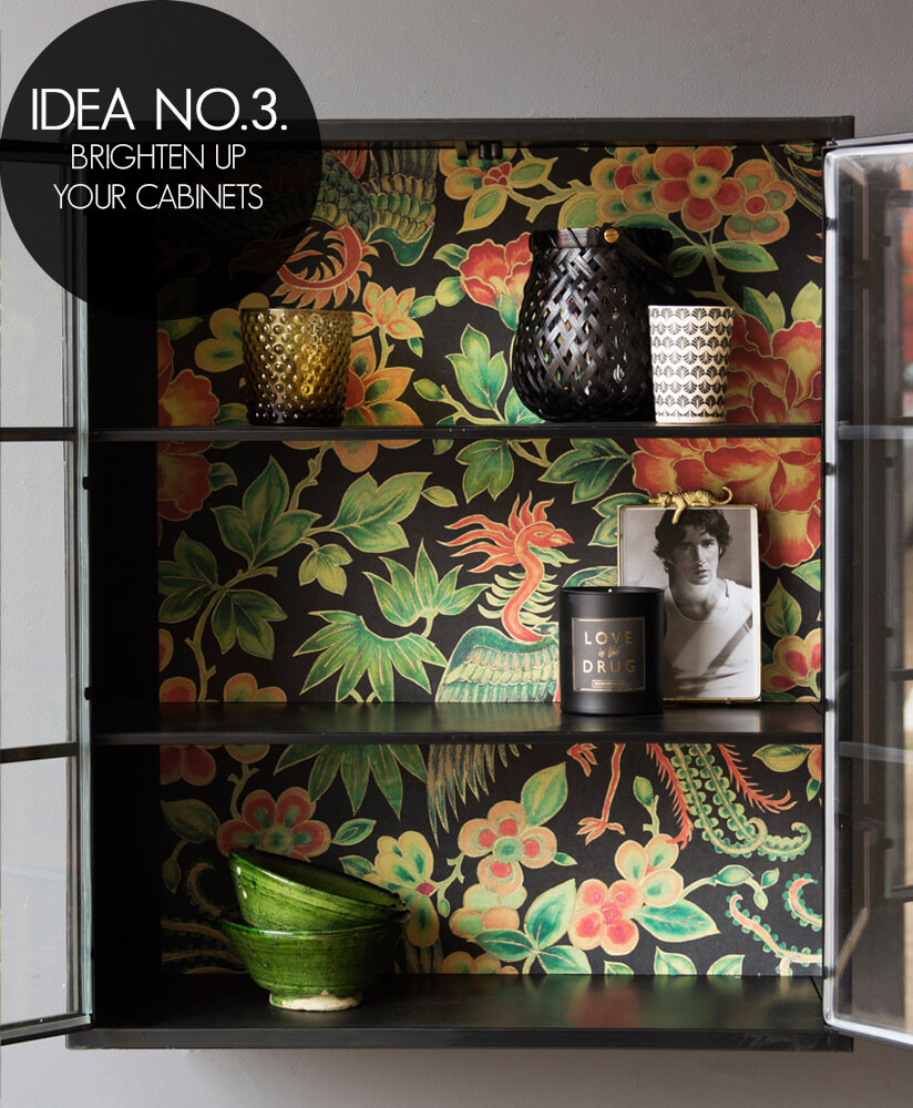 Idea 3 - Brighten up your cabinets with wallpaper.