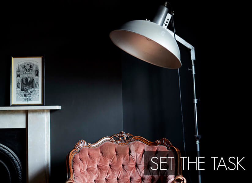 Set The Task: Large floor lamp above a traditional tufted armchair