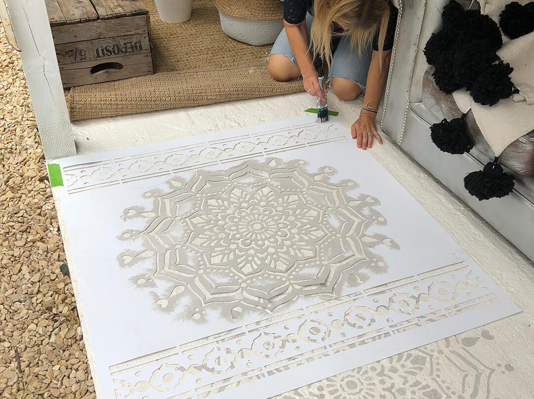 painting the floor with mandala floor stencil