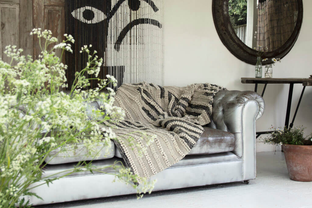 The Rockett St George Bamboo Door Curtain - Black & White Design and the Natural Cotton Rug.