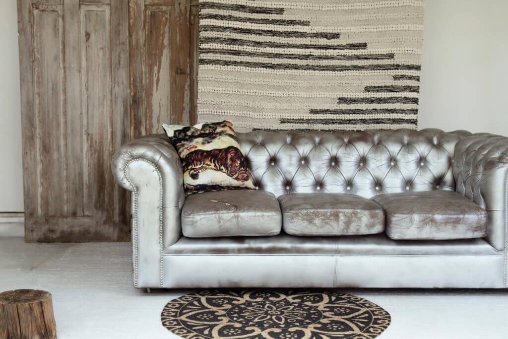 The Rockett St George Bengal Black & Natural Cotton Rug | Sleeping Tiger Velvet Cushion | Black Mandala Pattern Natural Jute Circular Rug.