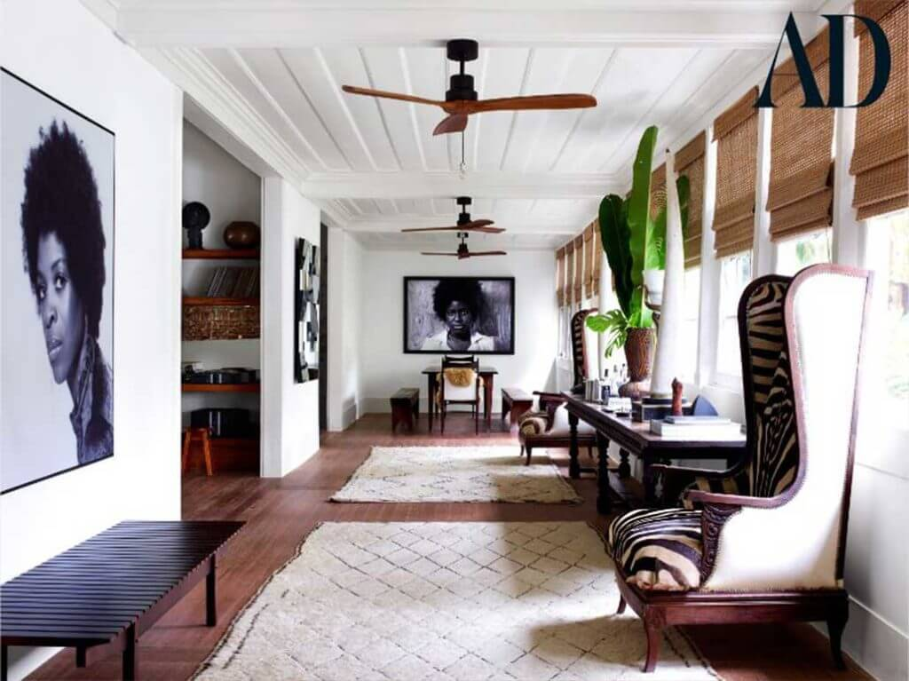 Lenny Kravitz's hallway in his Rio De Janerio home, featuring animal prints, giant photography and deep pile rugs.