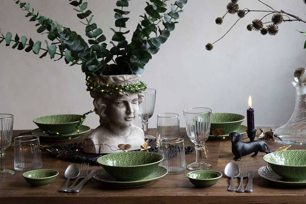 Lifestyle image of dining table setting with quirky ornaments.