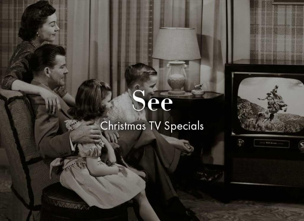 black and white picture of 1950s family watching television.