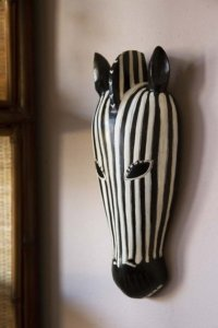 lifestyle image of African Style Wooden Zebra Head Wall Art