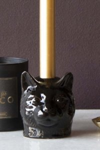lifestyle image of black cat candle holder for candlestick