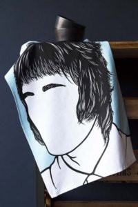 lifestyle image of rock icon tea towel with image of liam gallagher