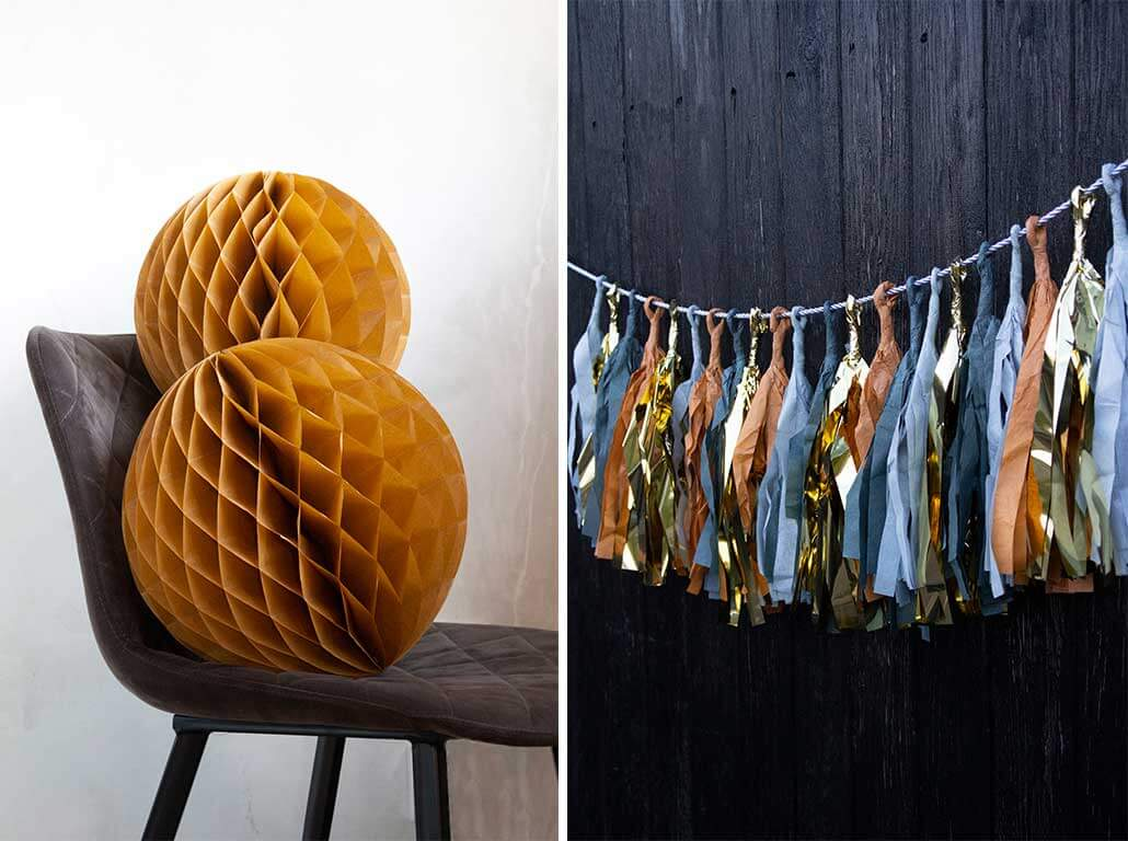 lifestyle grid of yellow paper honeycomb decorations and paper tassel garland