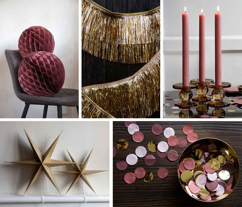 Pink Paper Honeycomb Decorations candles and gold star decorations for Christmas