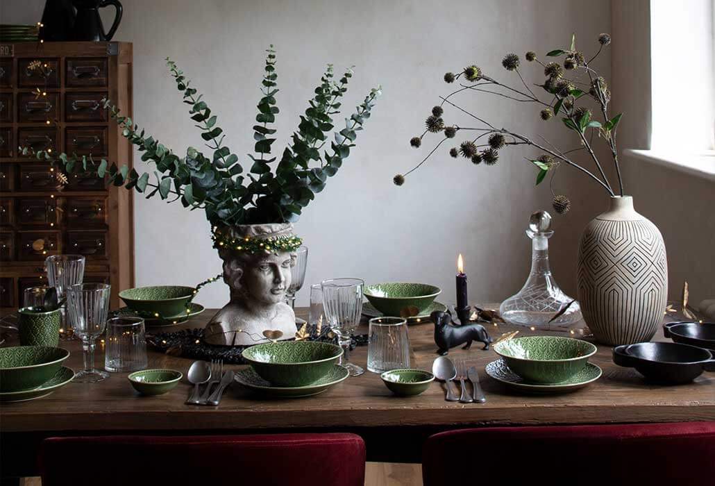 Lifestyle image of decorated christmas dinner table.