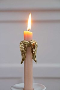 lifestyle image of gold angel wings candle ornament