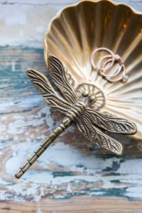 lifestyle image of gold dragonfly trinket dish
