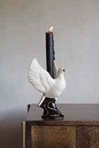 lifestyle image of black and white dove candle holder