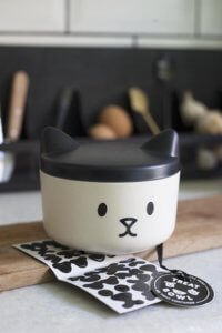 lifestyle image of cute Christmas stocking ideas - customisable cat pet treat container with stickers