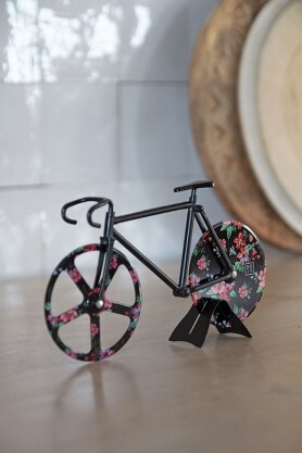 black and floral design bicycle pizza cutter