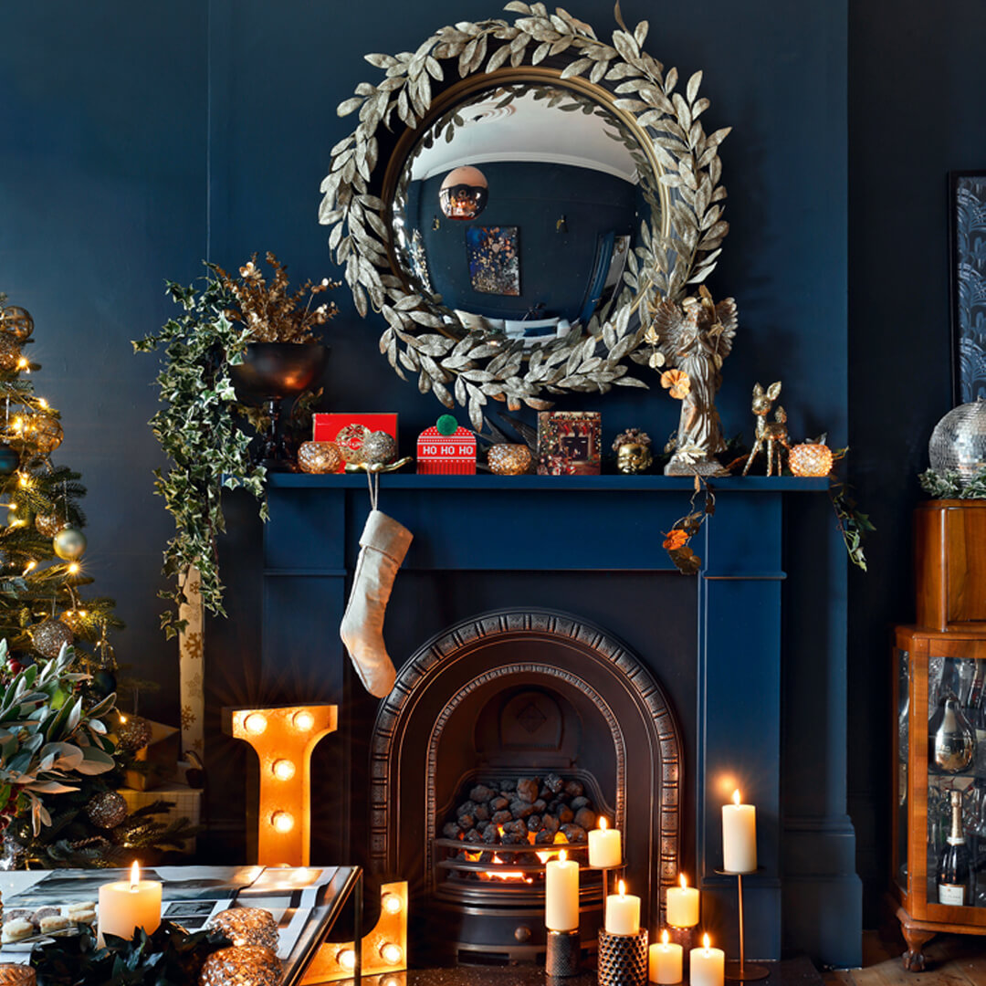 lifestyle image of Christmas party living room fireplace
