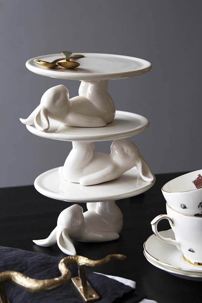 lifestyle image of cute Christmas stockings ideas - a set of 3 white rabbit cupcake plates stacked together
