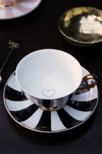 lifestyle image of black and white monochrome striped teacup and saucer