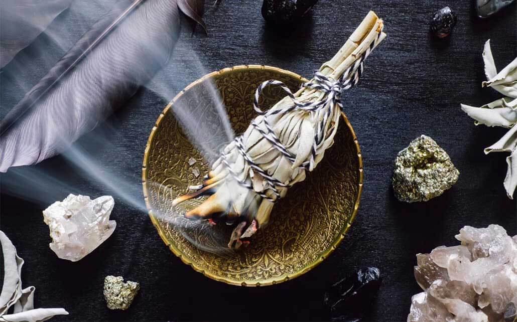 The ancient ritual of smudging with white sage
