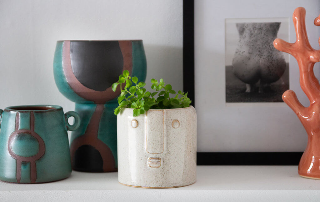 quirky and colourful vases on shelf