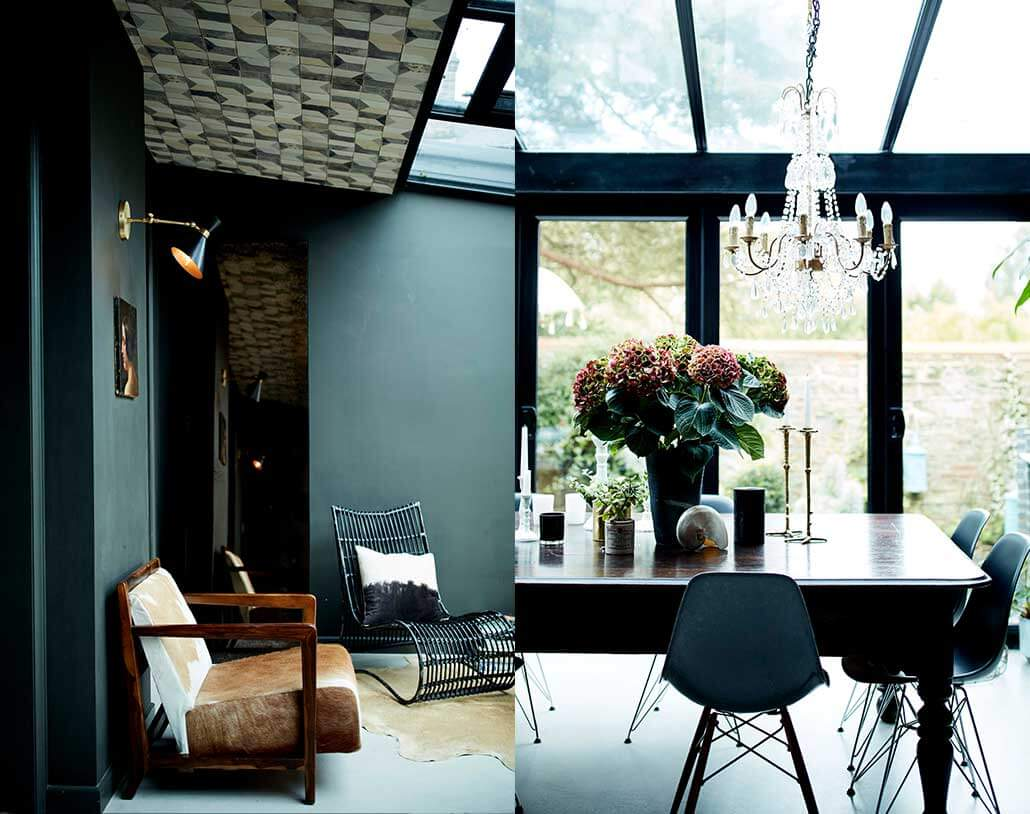 wall light positoned above art & chandelier positioned over a dining table
