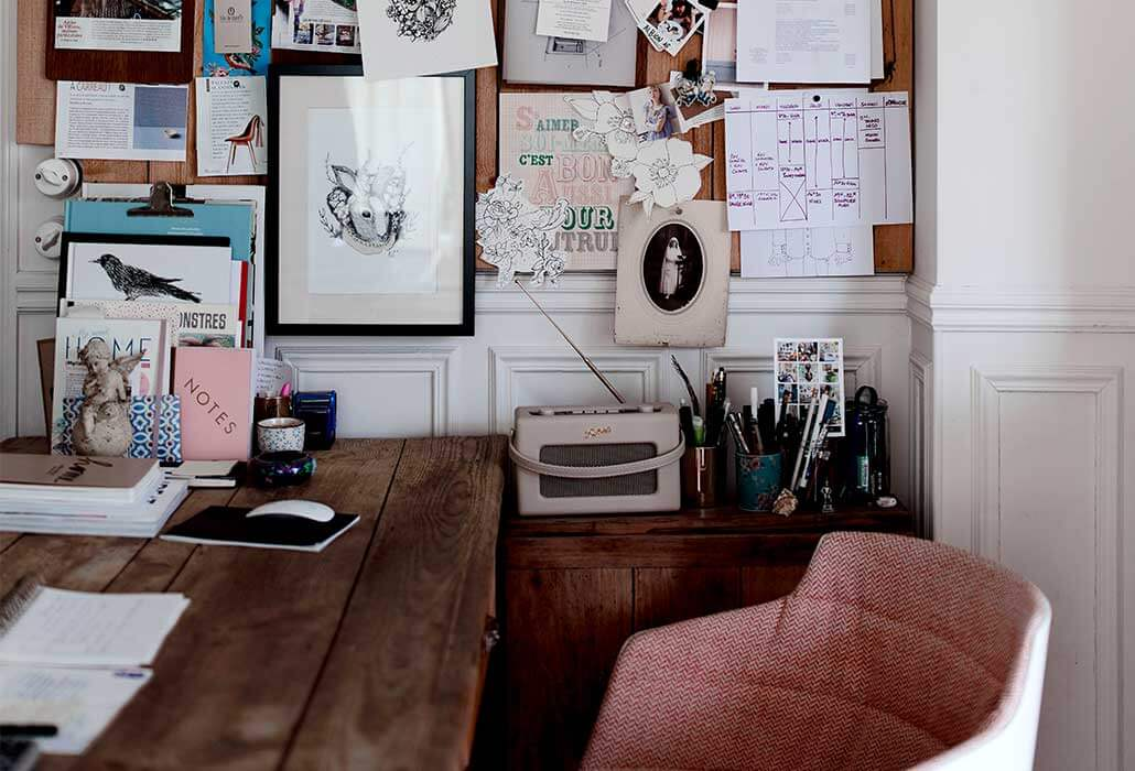 a country cottage style home office with a pinboard
