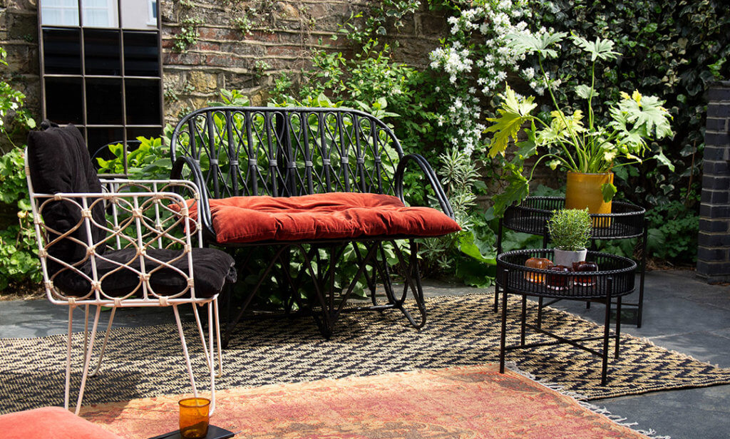 outdoor space styling with bench, chairs and mirrors